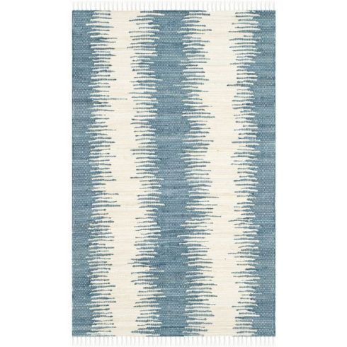The stripe is graphic, but has an organic feel. Montauk Rug by Safavieh on Wayfair.