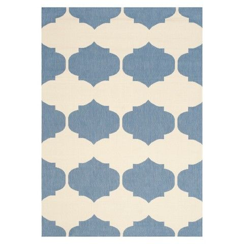 This is an indoor/outdoor rug, so I know it would stand up to dining room messes. I like the scale and shape of the pattern. Safavieh Patio Rug via Target.