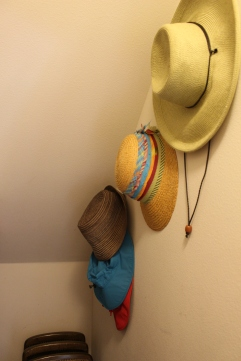 AFTER: The awkward angled wall space is put to good use with Command hooks for hanging hats.