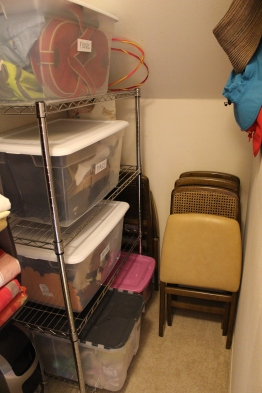 AFTER: A new shelving unit with clear bins is much easier to access.