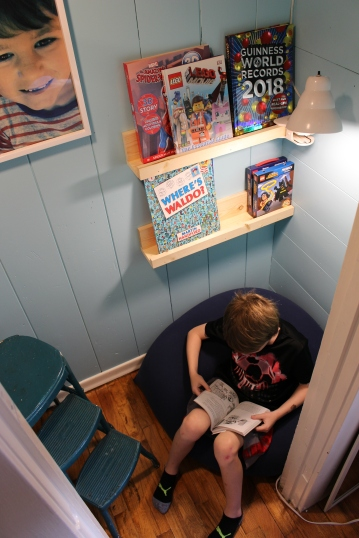 Now Thomas has a comfy spot to read and shelves to store his favorite books.